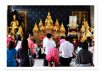 Thai people go to temple on Songkraan Day